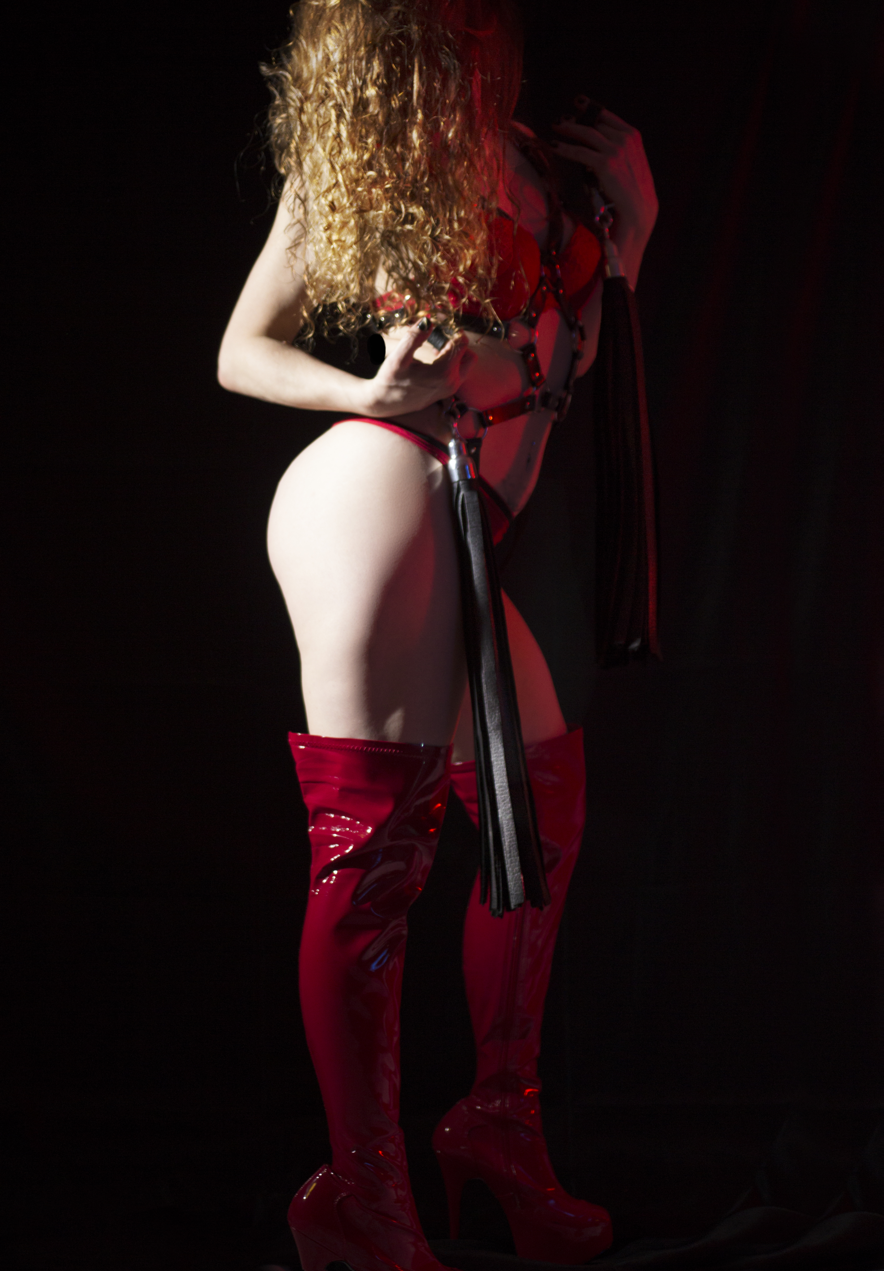 chicago dominatrix flogging floggers sensation play impact play high heel thigh high red pvc boots bottom worship smothering breath play leather flogger sensual tease and denial