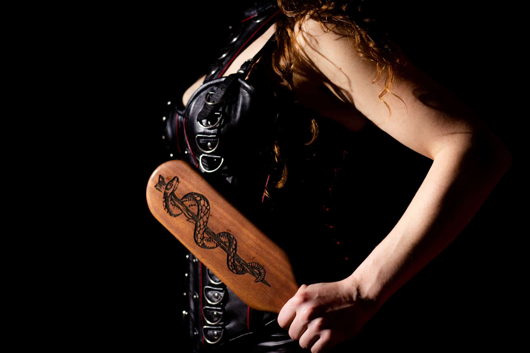 chicago dominatrix asclepius wooden paddle leather corset dominatrix powerful corporal punishment discipline paddling pain pleasure masochist sadist sadistic sadism
