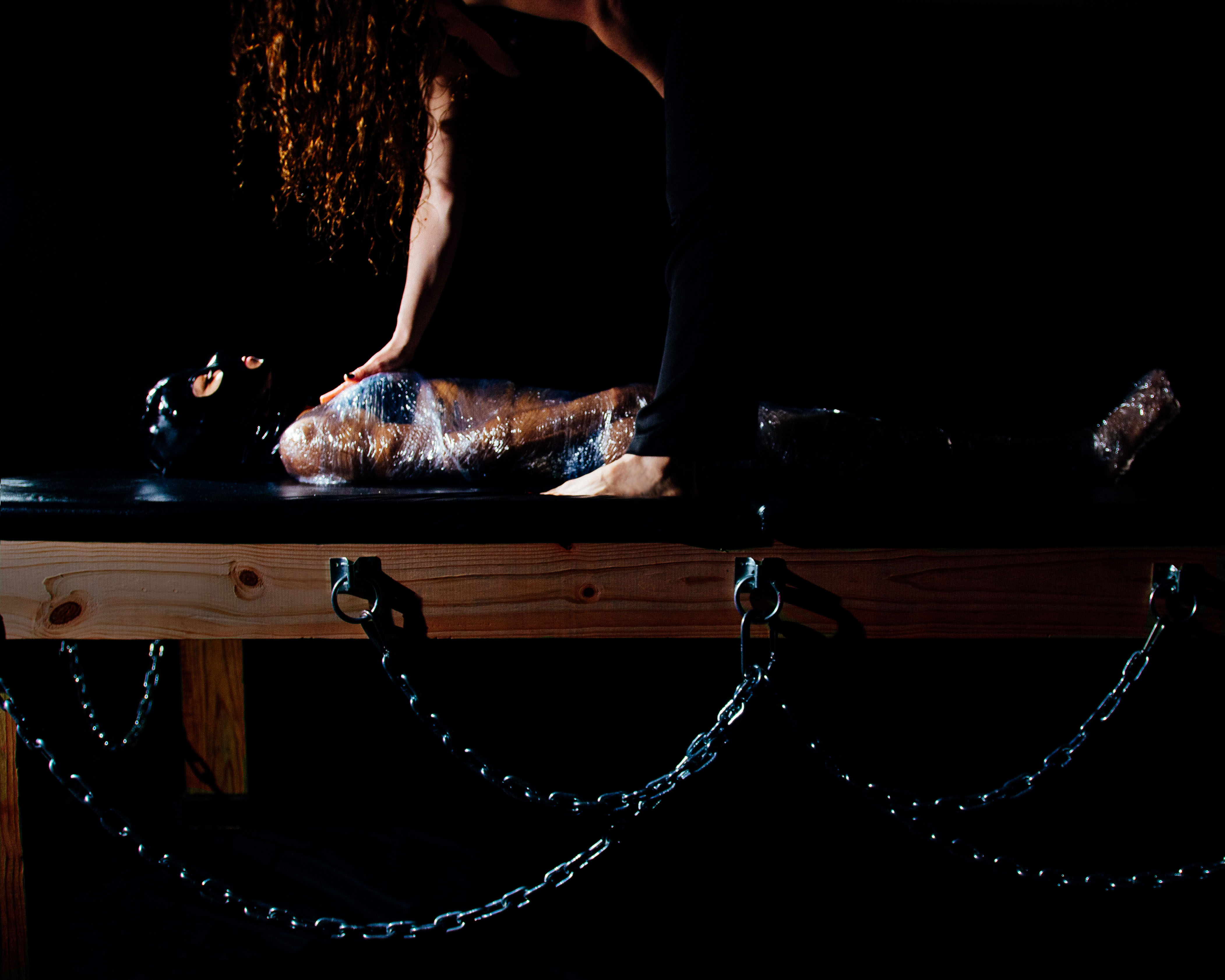 chicago dominatrix bondage table submissive mummification sensory deprivation chains saran wrap dominatrix